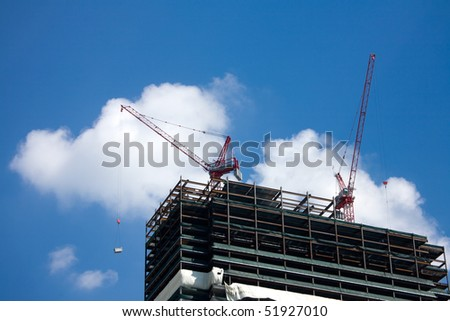Construction of modern skyscrapers and building crane