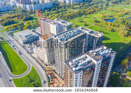 Construction of multi storey buildings near the city road and the park, aerial view Сток-фото ©