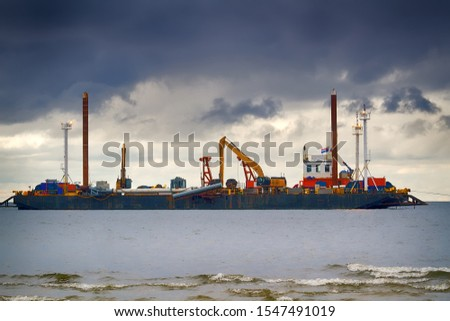 Construction of offshore section of gas pipeline on bottom of Baltic sea Nord stream-2. Auxiliary vessels at sea. Draghi's (dredging vessel) work on deepening sea Bay. Shallow water trenching barge  #1547491019