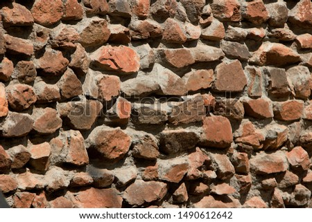 Construction of rubble stone masonry wall with dressed face bonded with cement concrete