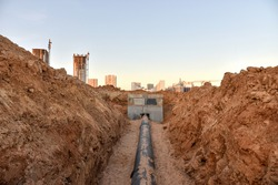 Construction of stormwater pits, sanitary sewer system distribution chamber and pump station. Construction the sewerage valve pit, manhole and pipes line. Sewage treatment works
