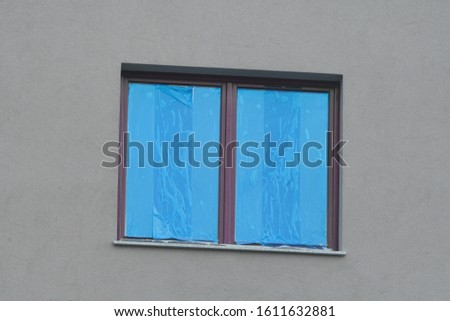 construction or reconstruction, repair of the house. replacement of Windows, painting of external walls. glass in a protective blue film. waiting for cleaning.