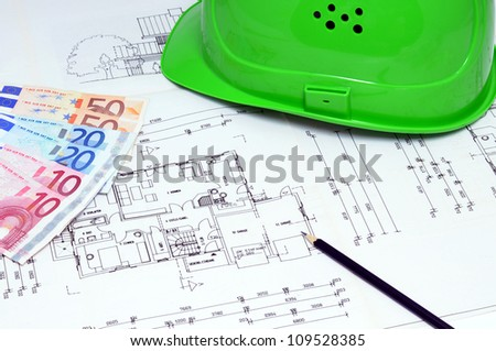 Construction plan with hardhat and Euro currency