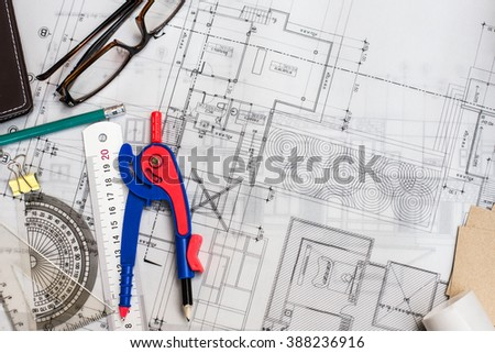 Construction planning drawings on the table with pencils, ruler and glasses on the table, retro effect #388236916