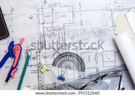 Construction planning drawings on the table with pencils, ruler and glasses on the table, retro effect. #391312660