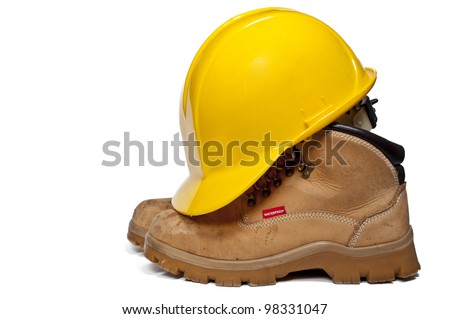 Construction PPE - Steel toe boots and a yellow hard hat