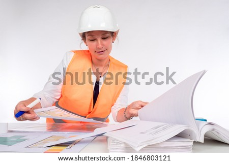 Construction project. Checking construction documentation. Engineering design. Documentation for a new house. A woman works in an architectural office. stock photo