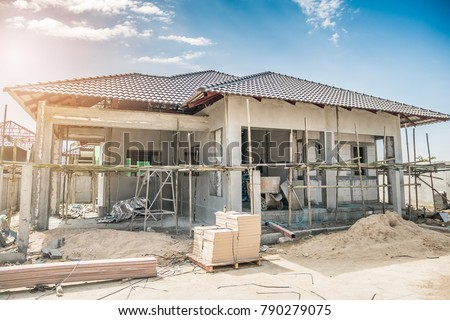 construction residential new house in progress at building site #790279075