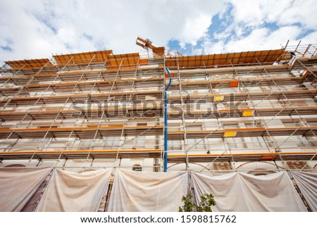 Construction Scaffoldings. Reconstruction of an architectural monument. Historical place.Concrete building.