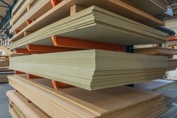 Construction sheet materials stored on cantilever rack in joinery workshop.
