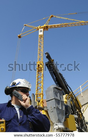 construction site and engineer, cranes in background