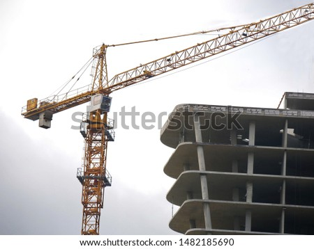 Construction site background. Construction site with crane and building.  #1482185690