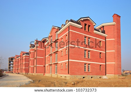 Construction site depicting a newly built apartment block