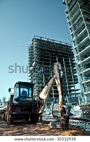 Construction site - excavator and high scaffolds #30332938