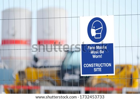Construction site face mask must be worn sign stock photo