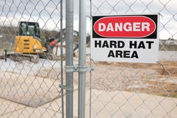 Construction Site Fence With Danger Hard Hat Area Warning