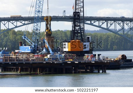 Construction site for a new bridge, dredging work, Portland OR.