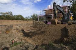 Construction site foundation with excavato