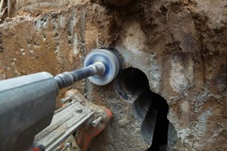 Construction site Infrastructure of urban sewer engineering networks and lines. Diamond drilling