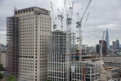 Construction site new skyscraper in London city seen from millennium wheel