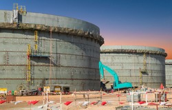 Construction site of oil and gas industrial, Huge oil storage tank ,Heavy construction machine doing building  with the workers