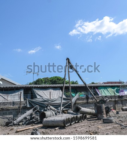construction site  piling equipment. Building house.  three legs metal steel crane.