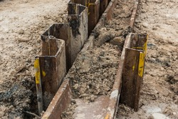Construction site. Retaining wall steel sheet pile work installation finish