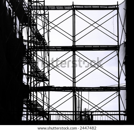 Construction Site Scaffolding -- seen as a silhouette with ladders and safety nets