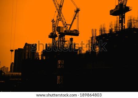 Construction site - silhouette built crane structure industry