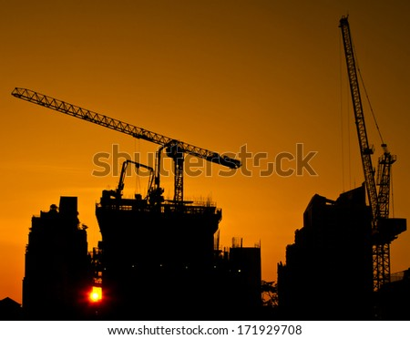 construction site - silhouette engineering building sunset project tower crane working