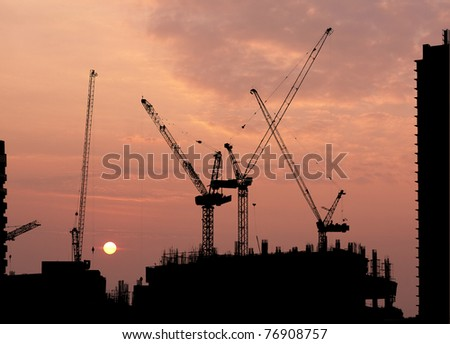 construction site silhouette on sunset