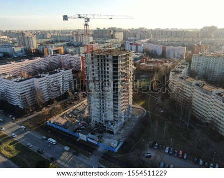 Construction site with a drone, monolithic residential complex 'Shuvalovsky Park', construction progress from 11/07/2019. The weather is clear. A crane near a building under construction. Сток-фото ©