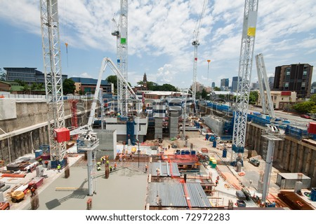 construction site with a few cranes at early stage (brisbane, qld, australia) - all logos and names removed