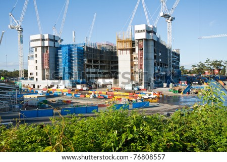 construction site with a few cranes at final stage (gold coast, qld, australia) - all logos and names removed