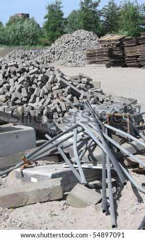 Construction site with building materials, stored outside