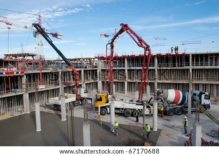 Construction site with cement mixer and blue sky