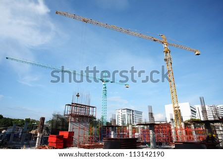 construction site with crane working. - stock photo