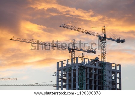 Construction site with cranes against the background of the evening sky stock photo