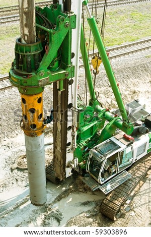 Construction site with drilling machine