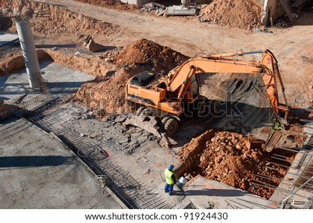 Construction site with excavating equipment