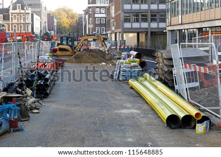 Construction site with material and machinery in the city