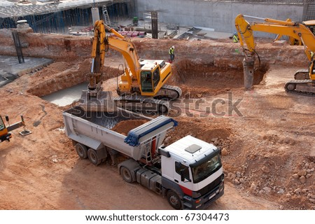 Construction site with tractors and dump truck