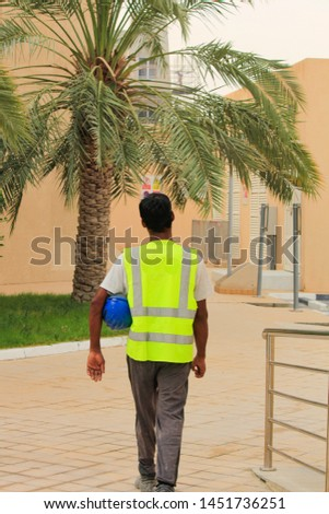 Construction site worker walking for work in Arab country. surveyor, foreman, engineer,industrial worker #1451736251