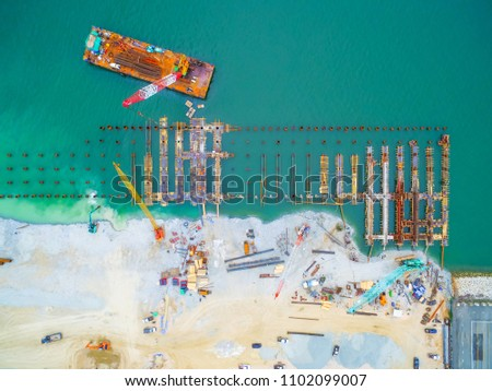 Construction site workers - aerial - Top View : for Marine works this picture for Construction Bert and Jetty, Construction Steel Pipe Pile used Piling Barge for driven pile.