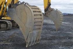 construction site yellow excavator hydrolic digging equipment shovel closeup