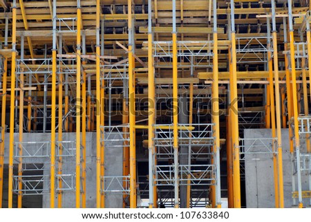 Construction site yellow scaffolding workplace