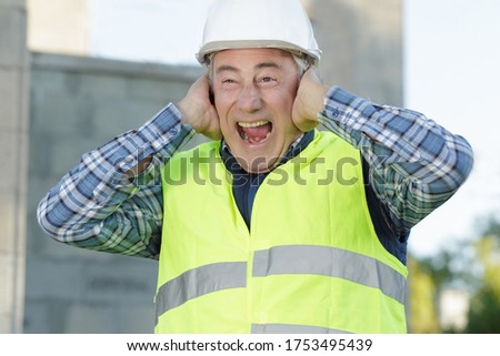 construction suffering from noise pollution on building site ストックフォト ©