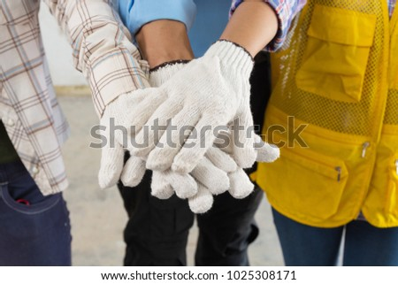 Construction Team Handshake or Join Hand of People in Real Estate Project Development as Teamwork Collaboration or United together by Multiethnic Diverse Group Worker Concept
