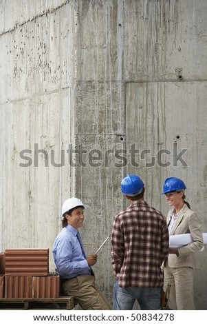 Construction team talking on site