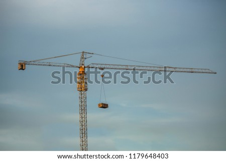Construction Theme: construction crane with blue sky and cloudy gray #1179648403